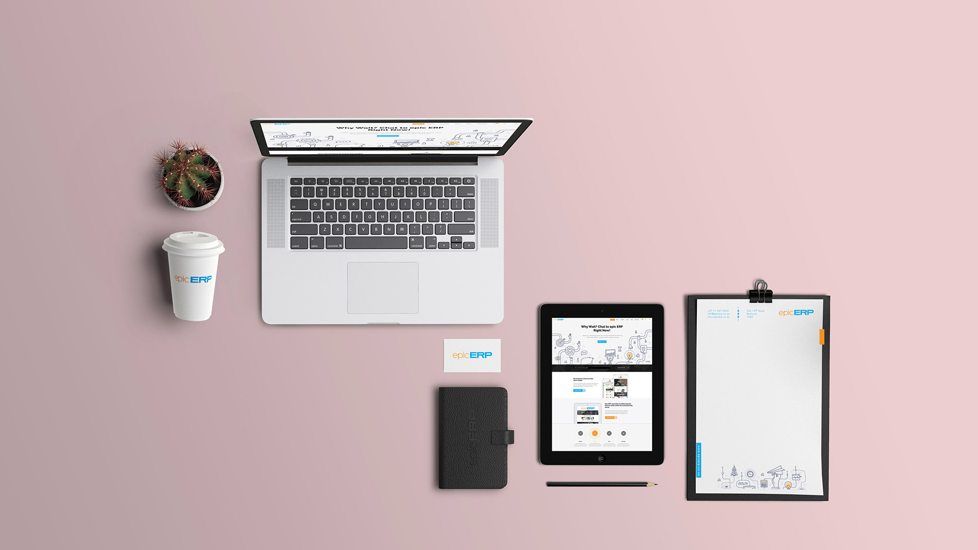 A table with laptop, book, tablet, and other stationary branded by black snow group